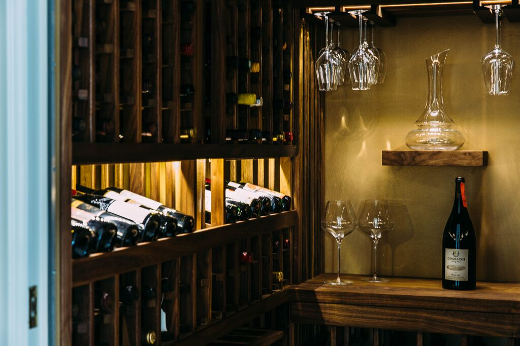 Transitional wine cellar on Los Angeles' Westside, inspired by France's Southern wine region; the Rhone and for an affinity with the nature of Mammoth Mountain.